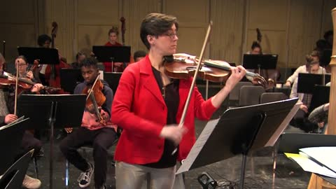 Nicolet High School students work with alum turned professional violinist