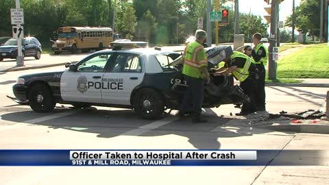 Officer taken to hospital following crash near 91st and Mill Road