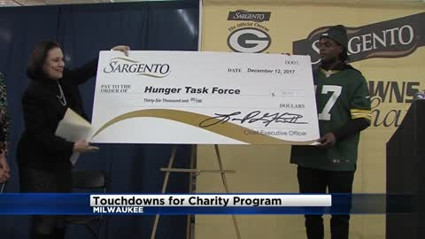 "Packers' Davante Adams peppered with questions about Aaron Rodgers during ""Touchdowns for Charity"" stop in Milwaukee"