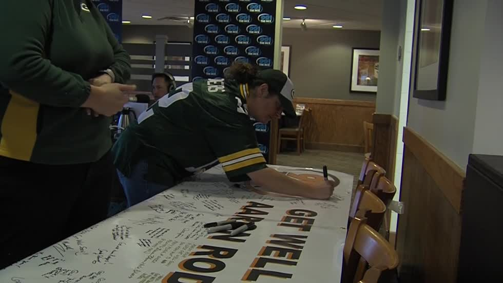 Packers fans sign get well banner for Rodgers