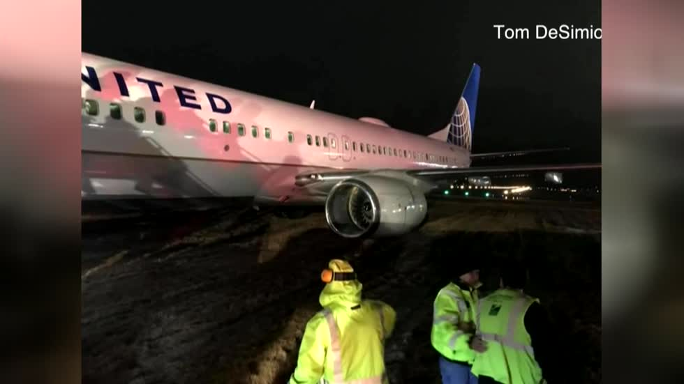 Diverted plane slides off the runway in Green Bay