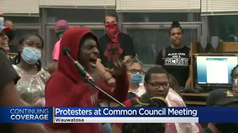 Protesters gather in Wauwatosa, interrupt Common Council meeting...