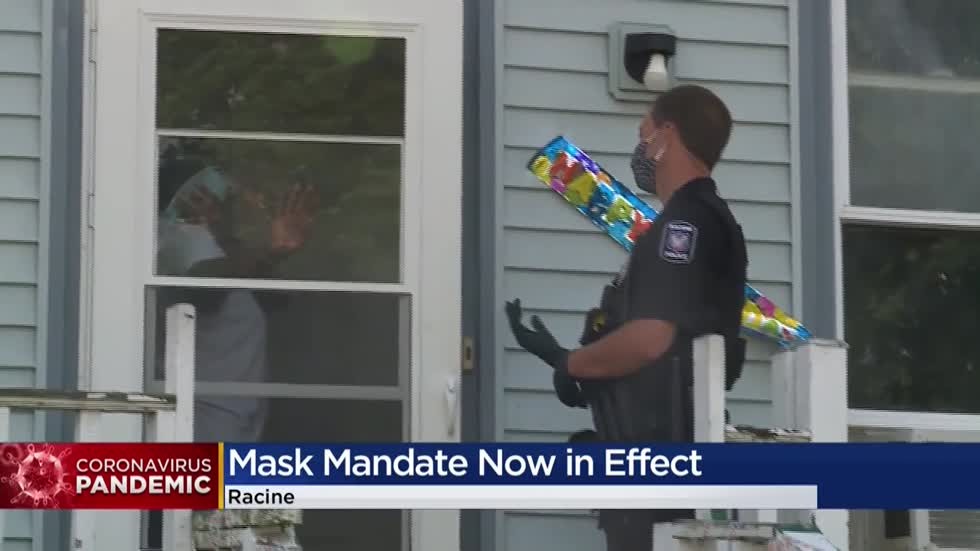 Racine Police Department hands out free masks as citywide mandate goes into effect