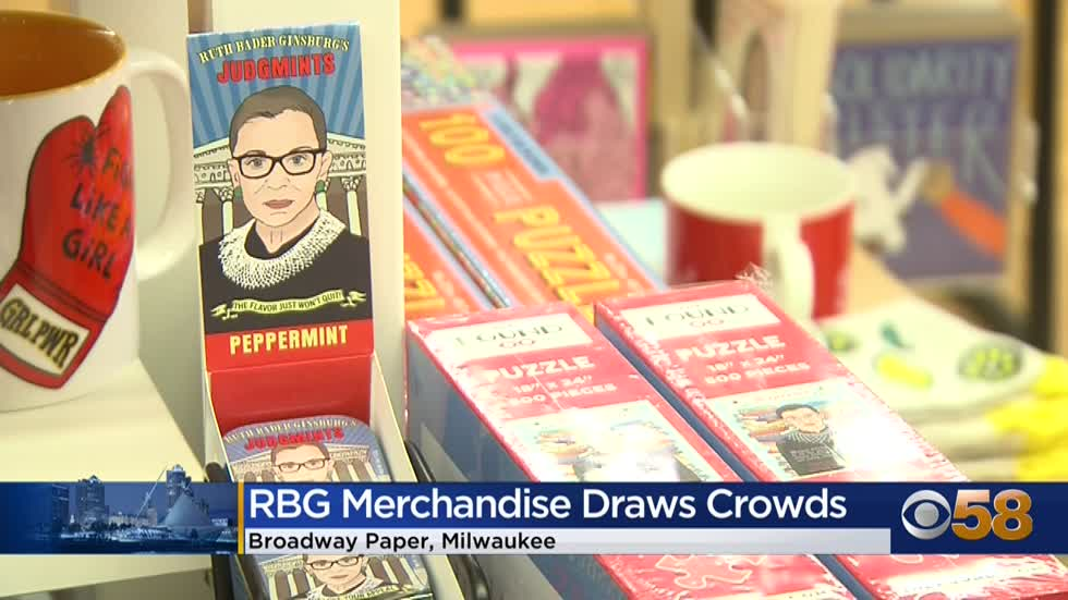 Crowds line up outside stores selling RBG merchandise following...