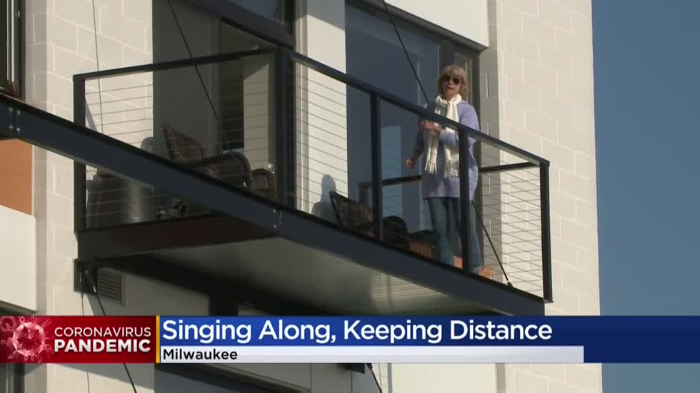 Third Ward residents practice social distancing while singing together from their balconies