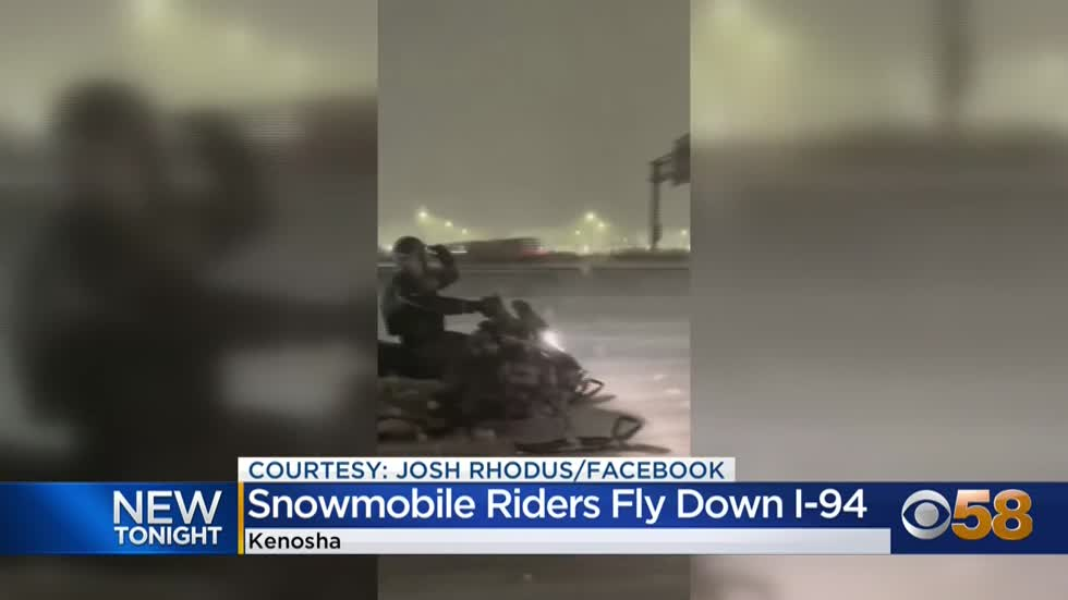Video: Snowmobilers seen riding on Wisconsin highway during winter snowstorm