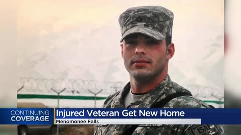 'It's the least we can do': Wounded war hero awarded new...