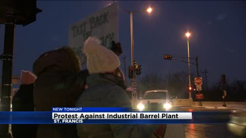 Several St. Francis residents protest industrial barrel plant