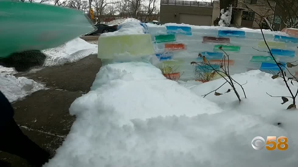 Milwaukee couple's frozen ice wall adds color and fun to February...