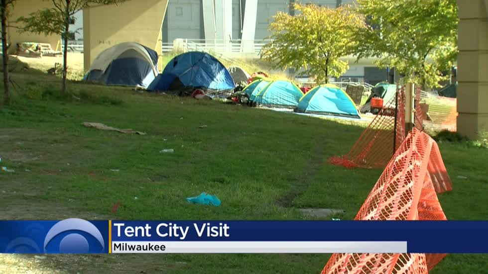 Volunteers bring food to remaining people in 'Tent City' encampment