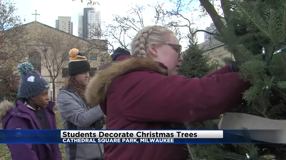 Children decorate trees for Holiday Lights Festival