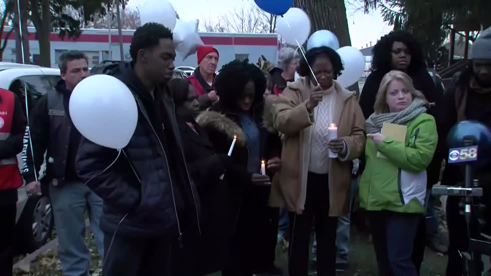 """We need to put these guns down:"" Vigil held for Donovan Hines, shot and killed near 29th and Hampton"