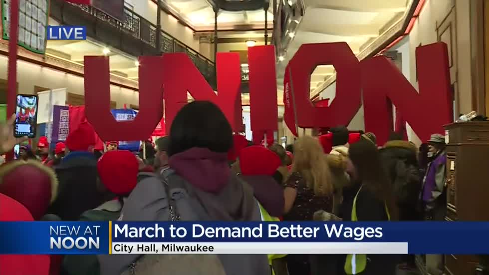 Hospitality workers march to Milwaukee's City Hall demanding higher wages, better benefits