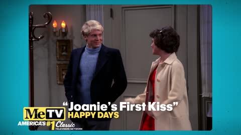 It's Joanie's first kiss on Happy Days!