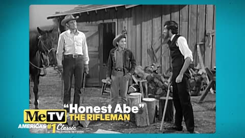 Abe Lincoln shows Mark McCain how to split logs